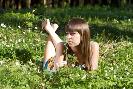 beautiful girl in forest on flowers field closeup Stock Photo - 13738854