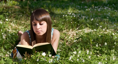 beautiful girl in forest on flowers field closeup Stock Photo
