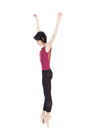 ballerina is dancing in the studio on a white background isolate