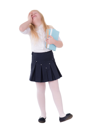 girl with blond hair in school uniform posing in studio on white background isolate Stock Photo