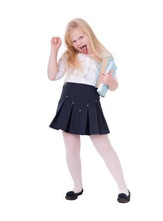 Fille aux cheveux blonds dans l & # 39 ; uniforme scolaire posant en studio sur fond blanc isolat Banque d'images - 92056747