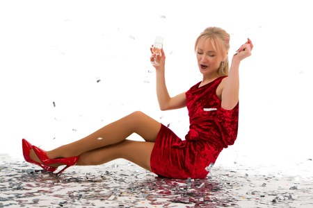 beautiful girl posing in the studio on a white background with glasses of champagne and in dresses for a party.