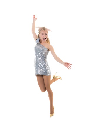 one beautiful happy girl jumping in the studio on a white background. the joy of shopping. freezing jump - flying girl.