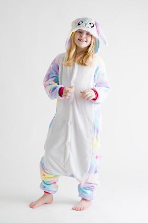 modern fashion - beautiful blonde girl posing on a white background in kigurumi pajamas, bunny costume Фото со стока