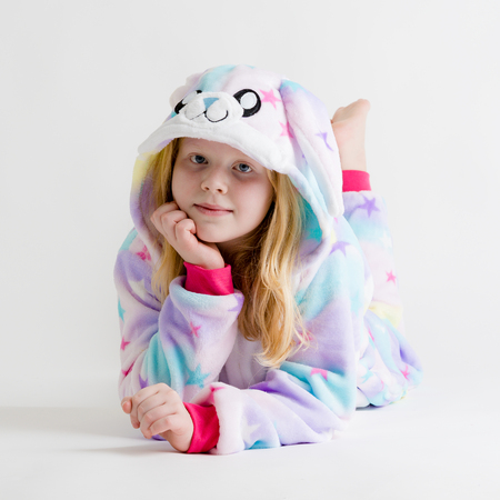 modern fashion - beautiful blonde girl posing on a white background in kigurumi pajamas, bunny costume Stock Photo