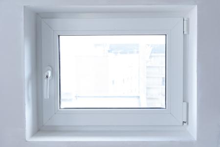white plastic PVC window indoors close-up