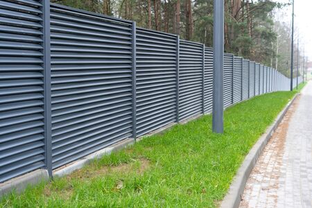 blank metal fence in the village Stockfoto