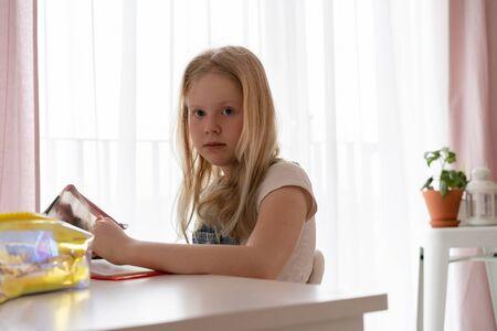 education and development. Beautiful teenage girl doing homework in her room Stock Photo