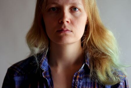 portrait of a simple serious woman without makeup