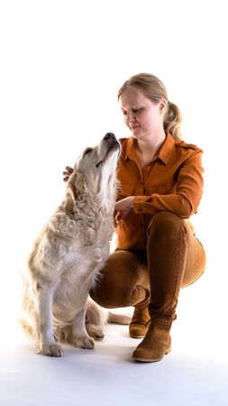 love for pets. studio portrait of a woman and golden retriever in studio on a white background.