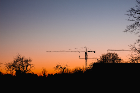 building sector: Tower crane on the sunset sky background Stock Photo