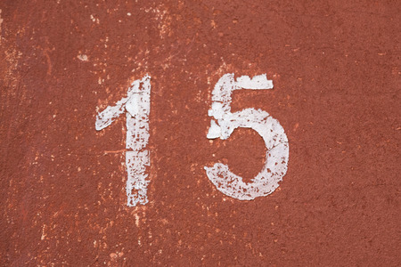 fifteen: Number fifteen on the old wall of red color Stock Photo