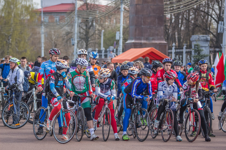 bicycling: Gomel, Belarus - April 10, 2016: Velosports on Lenin Square at the opening of bicycling season 2016 Editorial
