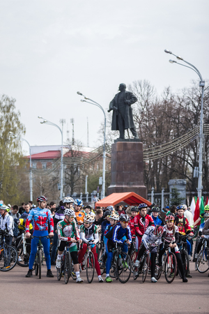 bicyclists: Gomel, Belarus - April 10, 2016: Bicyclists city Gomel getting ready to start the bike ride on Lenin Square