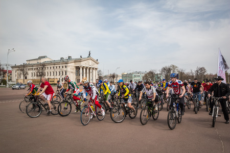 bicyclists: Gomel, Belarus - April 10, 2016: Bicyclists begin movement in honor of the bicycle season in 2016 on Lenin Square