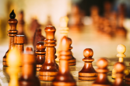 Chess wooden figures in a blur. Installing the game of chess Stock Photo