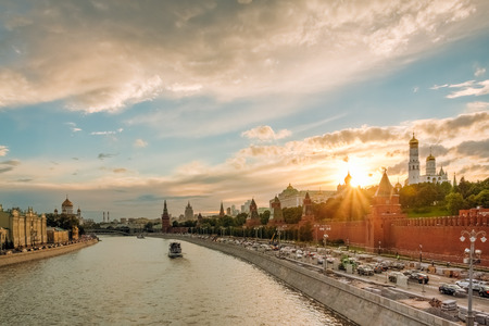 Embankment Moscow river Kremlin wall and churches Kremlin on a background of a summer sunset