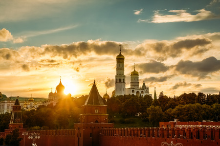 the great wall and the fall: Belfry of Ivan the Great Cathedral in the Kremlin in Moscow on a background of a beautiful sunset