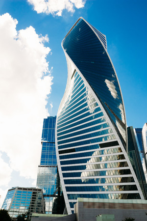 megapolis: Moscow, Russia - August 16, 2016: Beautiful glass building-Evolution against the blue cloudy sky