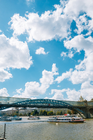 foot bridge: Moscow, Russia - August 17, 2016: Pushkin foot bridge under which runs river boats