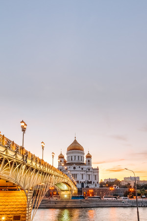 patriarchal: View of the Cathedral of Christ the Savior and the Patriarchal bridge pedestrian. Evening time Stock Photo