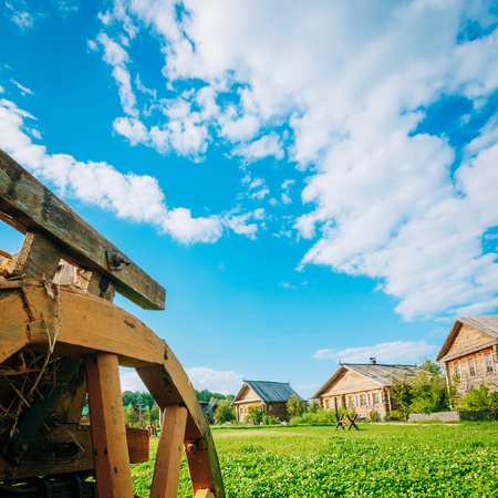 Country landscape with farmhouses and beautiful blue sky with cumulus clouds in the background Stock Photo