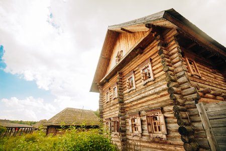 View of the two-storey timbered log hut Russian Stock Photo