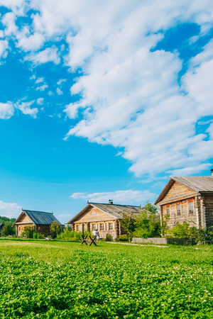 Russian log hut on a background of blue sky with clouds Stock Photo