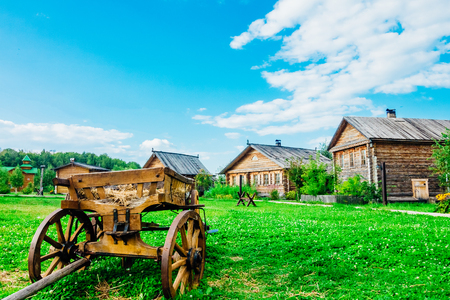 Rural landscape with a cart in the foreground Stock Photo