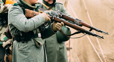 reenactmant: Wehrmacht soldiers with rifles in their hands. Reconstruction