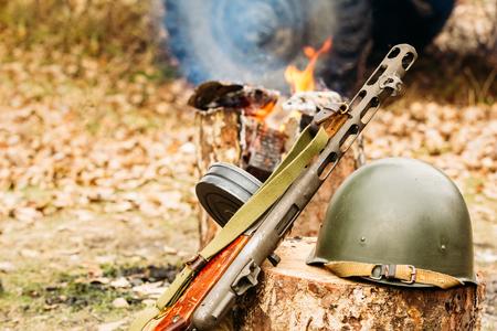 Submachine gun Shpagin and helmet