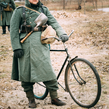 reenactmant: German soldier in uniform with a bicycle