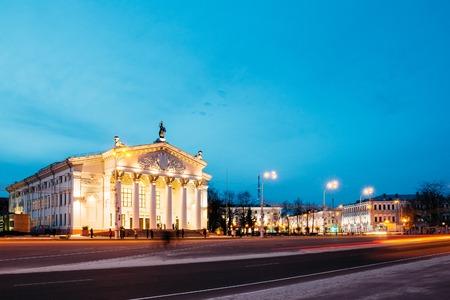 Beautiful views of the Gomel drama theater in the evening hours with a moving transport on long exposure