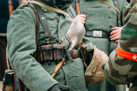 reenactmant: The actor in the form of a German soldier during the Second World War, with a shovel in his belt