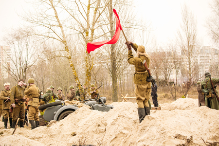 Soldier girl with a red banner. Gomel, Belarus