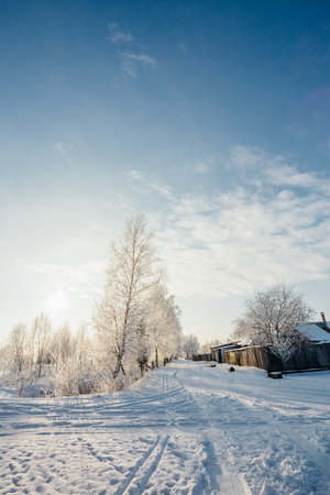 hoarfrost: Outskirts of the village in the snow in winter Stock Photo