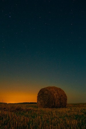 Landscape with a haystack and stars in the sky Imagens