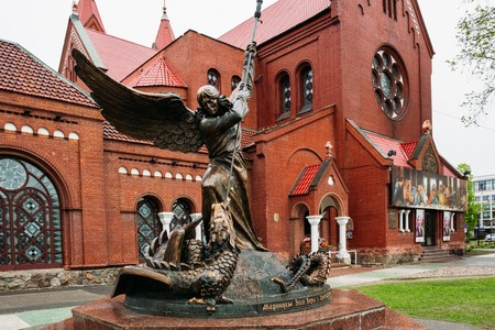 Archangel Michael with wings and spear sculpture at the temple.