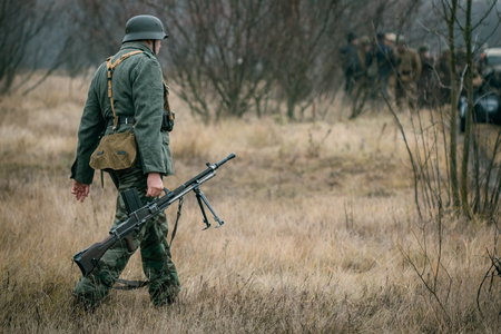 German soldier with a machine gun in the field Stock Photo