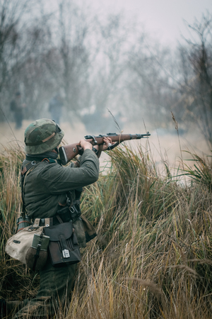 Soldier Wehrmacht shoots with a rifle
