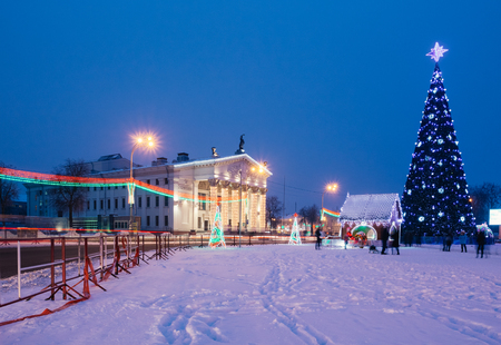 Area of the city with Christmas decorations and a Christmas tree
