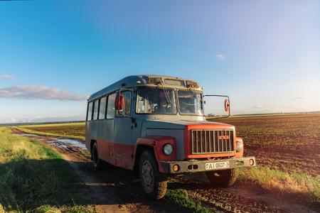 Old Soviet truck on a dirty road with puddles in the field. Dobr
