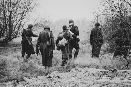 The soldiers of the red army in their overcoats go to the positi