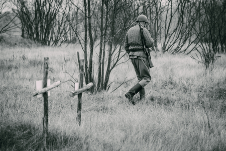 Red Army soldier at the time of the World War 2 at the graves wi