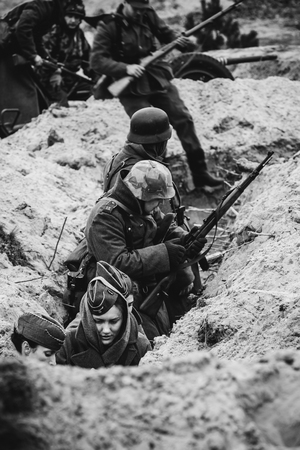 German soldiers Wehrmacht in the trenches on the reconstruction Editorial
