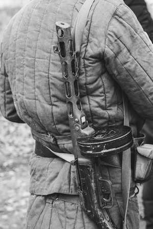Soviet PPSh machine gun on the back of a soldier on a black and white photo Stock Photo