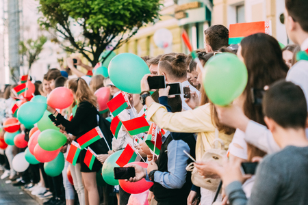 Gomel, Belarus - May 9, 2018: People with Belarusian flags rejoice on holiday - Victory Day in Gomel