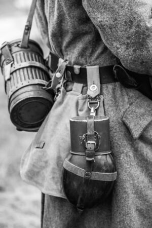 Water bottle on the belt of a German soldier from the Wehrmacht from the Second World War. Black and white photography
