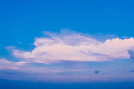 Bright picturesque sky of blue color with light clouds. Background 免版税图像