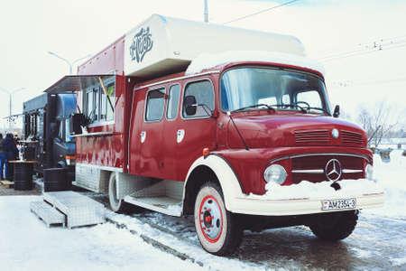 Gomel, Belarus - February 18, 2018: Raspberry Mercedes Food Truck sells fast food from the van